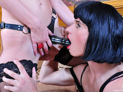 Sissy guy caught in a female evening dress gets impaled on a rubber cock